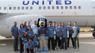 Plane pull photograph of hudson employees
