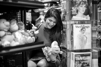 Customer at a Hudson Store grabbing a plust toy